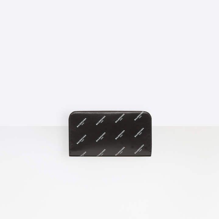677adc15d4b4 Balenciaga Metallic calfskin wallet with zipper closure and all over logo