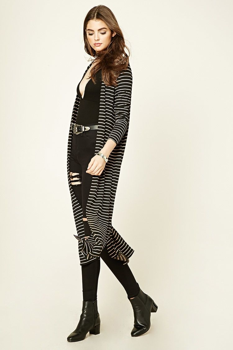 A striped maxi cardigan featuring a ribbed knit pattern, open ...