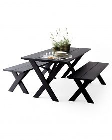 Turn your chipped, peeling, or sun-damaged picnic table into a chic statement with just a few coats of matte black paint.