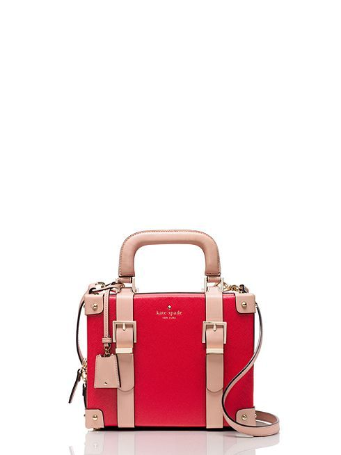 "there's no need to check this colorful little crossbody: inspired by the look of old-fashioned, high-end luggage, it's the perfect ""carry-on"" for a day or night out on the town."