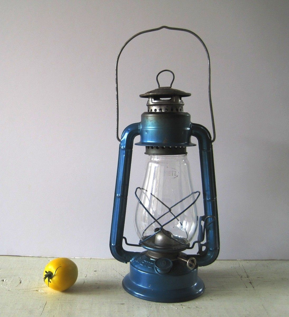 a blue vintage lantern  would be cute on his bookshelf