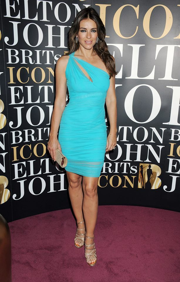In occasion of the Brits Icon Awards the gorgeous Liz Hurley chose to wear a short one shoulder Turquoise dress from Versace 2014 Resort collection. #VersaceCelebrities
