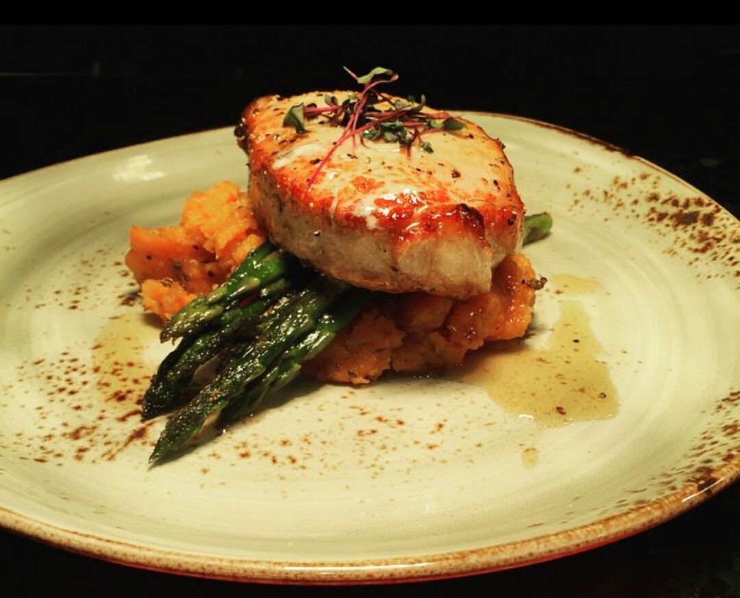 Does this pan seared pork chop served with chipotle sweet mash & asparagus leave your mouth watering?