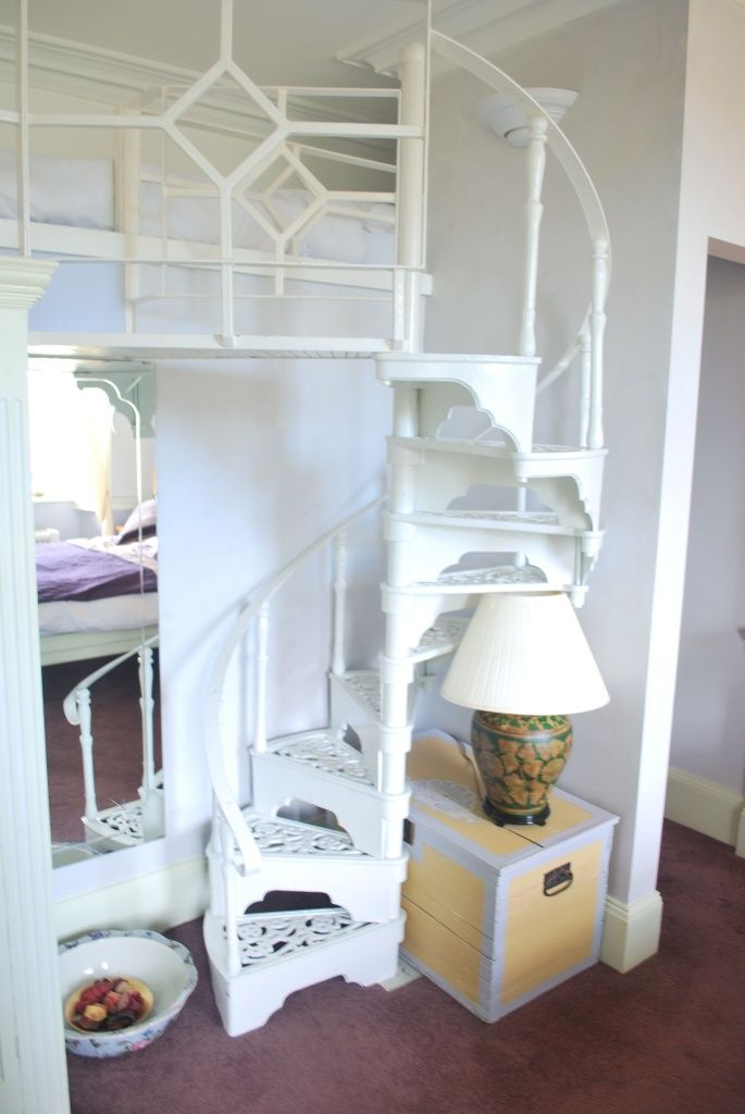 Country character-the spiral stairway to the bunk beds- a favourite with kids.