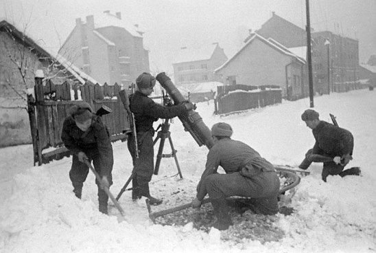 February 1945. Soviet mortarmen set mortar on the firing line in one of the districts of Budapest.