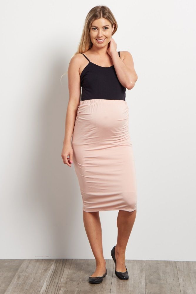 287bc8a4385 You will love the way this maternity pencil skirt shows off your belly this  season. A soft fabric and elastic waistband comfortably accommodate your  growing ...