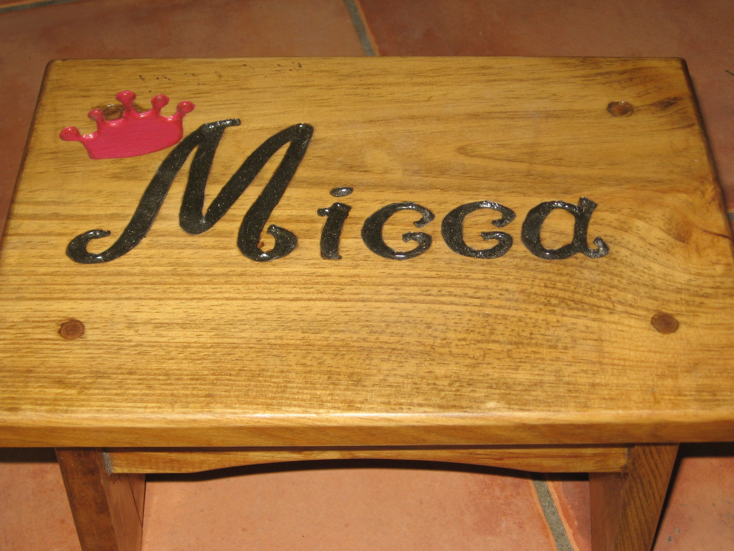 engraved a stepstool by making a stencil and carving out the letters with a dremel tool