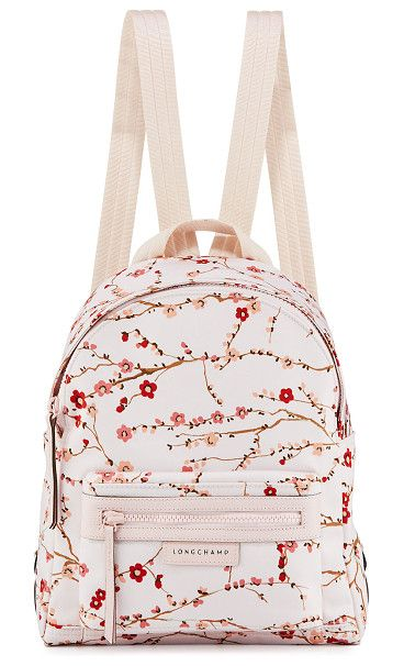 Le Pliage Néo Small Sakura Backpack by Longchamp. Longchamp nylon backpack  in cherry blossom print. Tonal hardware and leather trim. c904a7262d93f