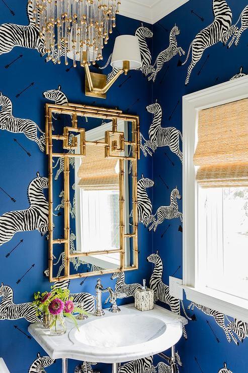 blue powder room boasts walls clad in scalamandre zebra denim wallpaper lined with a marble wall bohemian bathroombathroom ideaszebra