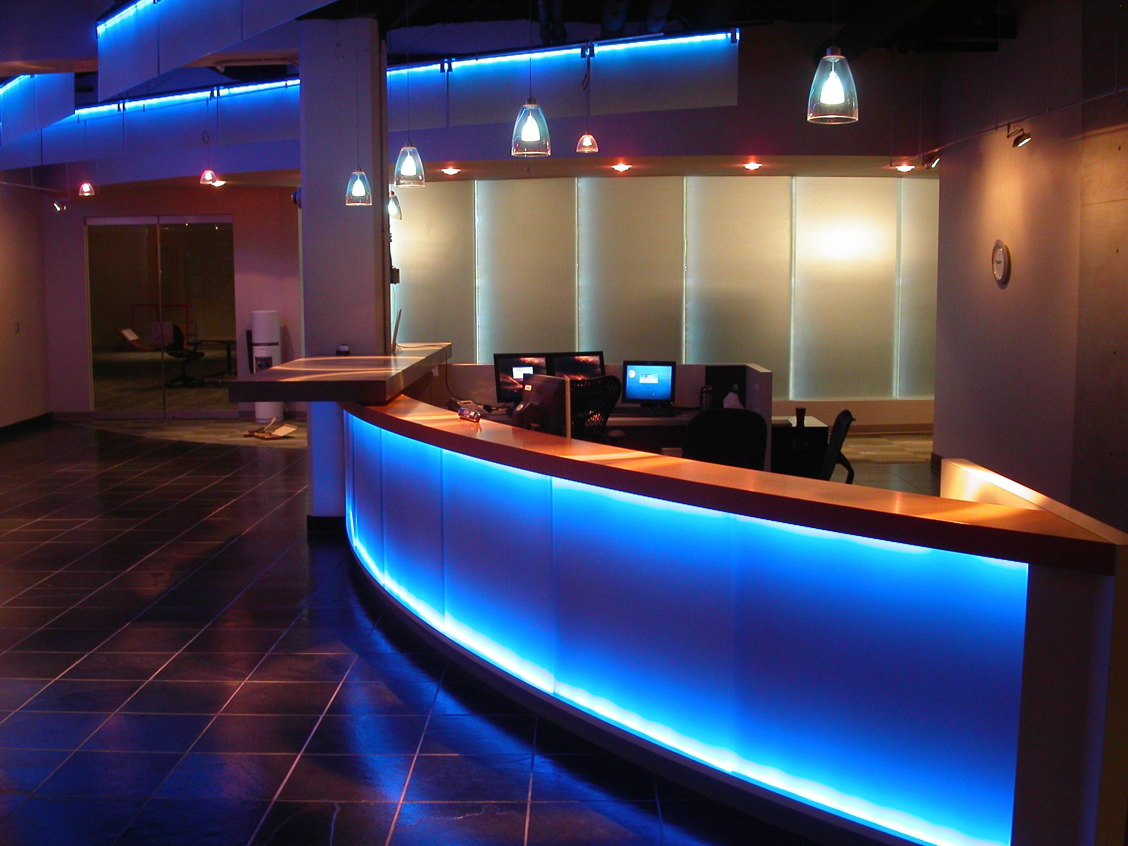 Exledu0027s LED Strip Lighting Highlighting Architectural Features And The Desk  Within An Office Reception Area