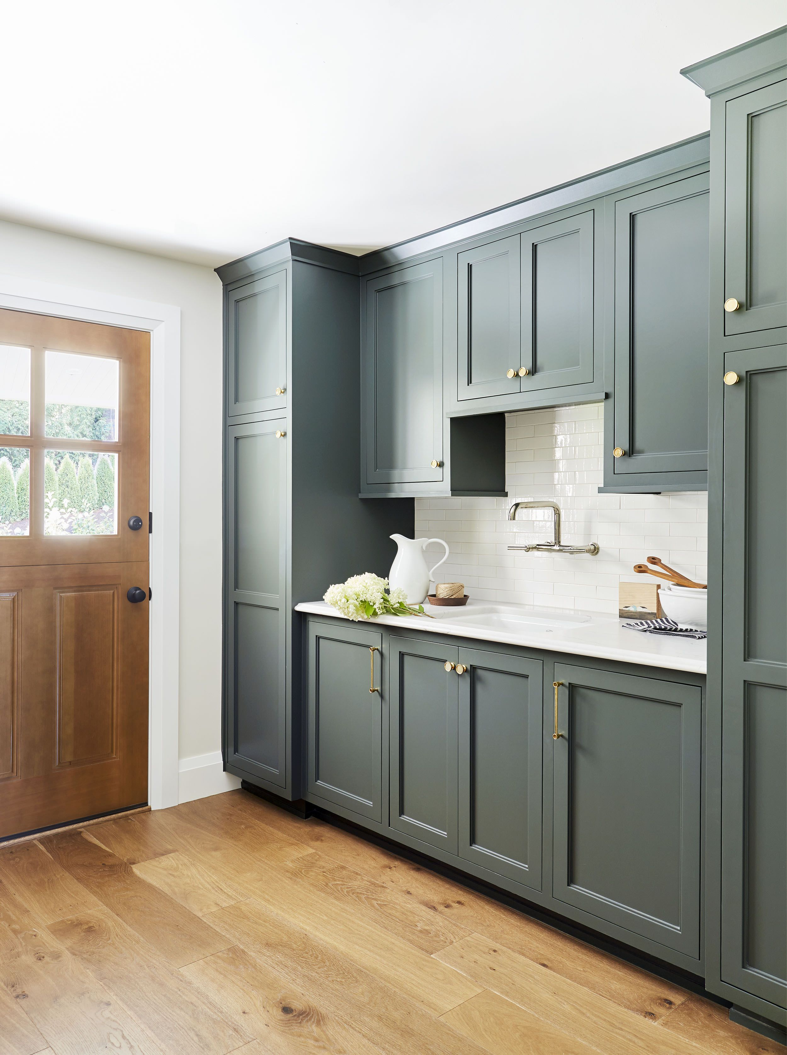 8 Steps To Building A Smart Organized Pantry Mudroom Emily Henderson Green Cabinets Mudroom Cabinets White Countertops