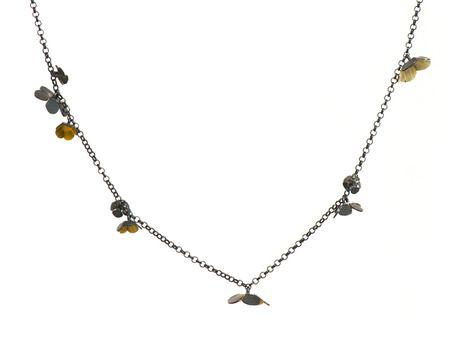 e.g.etal - Twiggy Weed neckpiece, Nina Ellis the little flower around the necklace are so cute