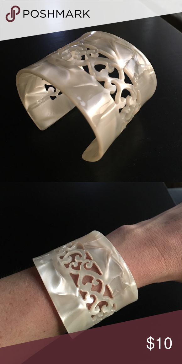 Ivory White Cuff Lace cut Bracelet White cuff bracelet with cut-outs. 5.5 inches around Jewelry Bracelets