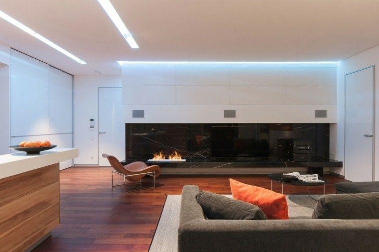salon moderno chimenea abierta gas marmol negro ideas Pisos