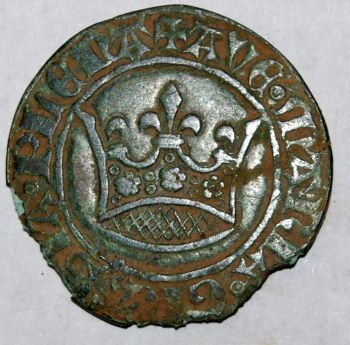 Metal detecting. This is a medieval token (or Jeton) found in the UK