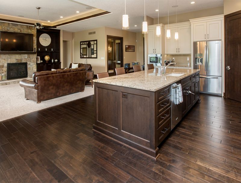 The kitchen island acts as a beautiful transition from ...
