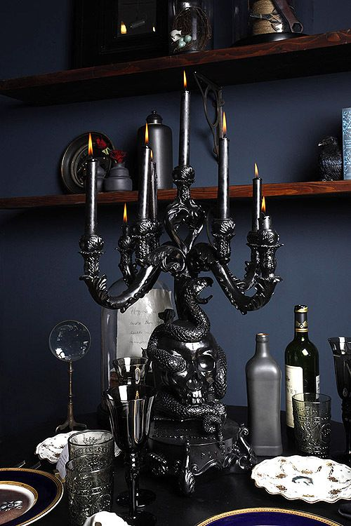 Back in black, this tablescape is influenced by Medieval decor. The candle holder serves as both a great centerpiece & candlescape. #gothic #indoor #decoration #hosting