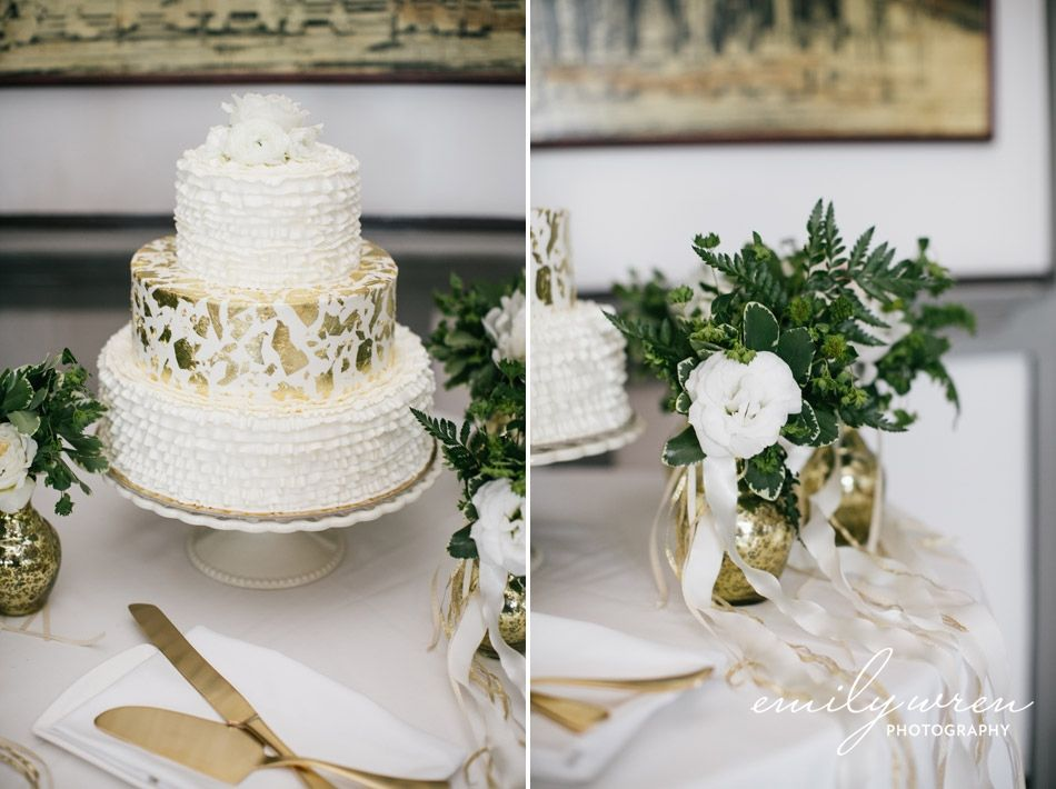 White wedding cake with gold on it! by Emily Wren Wedding Photography