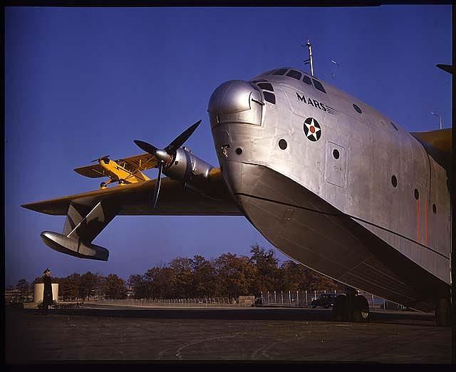 Piper J-3 sittin' pretty on the right wing of a Martin Mars flying boat. The Martin Mars aircraft was introduced November 30, 1943 when it made its first operational flight with the U.S. Navy. Photo by Hans Groenhoff. Source: Smithsonian National Air and Space Museum Archives