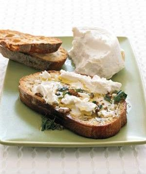 Goat Cheese Bruschetta | Real Simple  Ingredients  2 tablespoons balsamic vinegar  2 tablespoons chopped fresh herbs, such as dill, parsley, or basil  Slices toasted country bread  Goat cheese  3/4 cup Basic Vinaigrette  Directions  Add the vinegar and fresh herbs to the Basic Vinaigrette. Drizzle over bread and spread with goat cheese. Finish with another drizzle of vinaigrette