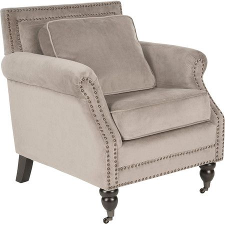 A handsome addition to your master suite or parlor, this classic arm chair showcases nailhead trim and a pillowed seat.  Product: