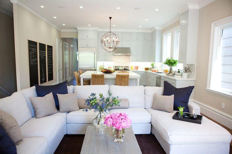 delightful white living room gray sofas suspended shelving | Marsh and Clark - living rooms - open floor plan, white ...