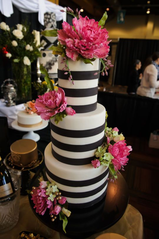 kate spade inspired black and white wedding cake with bright hot