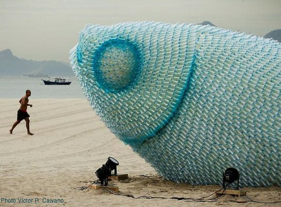 Giant Plastic Bottle Fish Sculptures Shimmer on a Rio Beach
