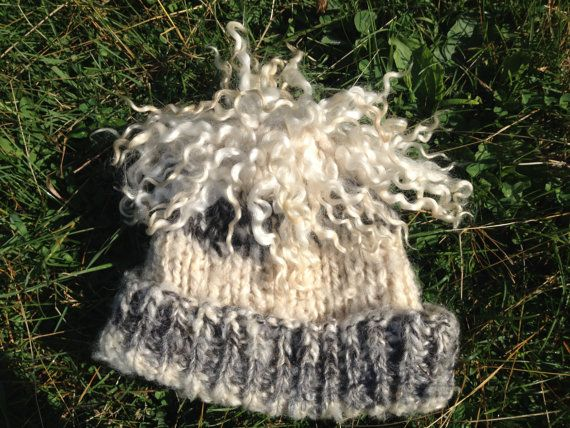 This hat is fun, all natural and completely handmade on the farm by the shepherdess. The white locks are high luster wensleydale wool that has bee