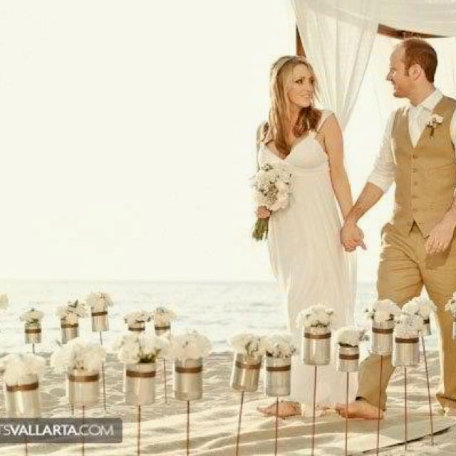 Beautiful beach ceremony isle decor...perfect since I want it to be sunset