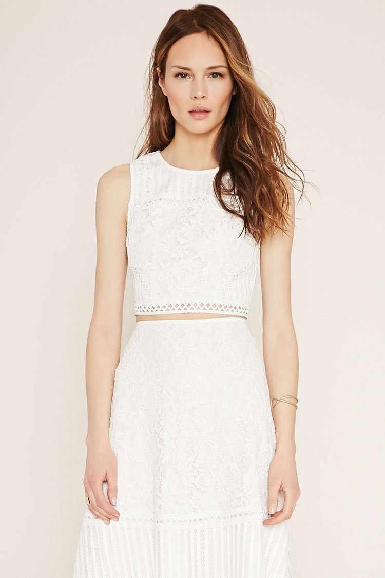 be99474e55c Forever 21 Contemporary - A knit floral lace crop top with linear crochet  accents throughout, a sleeveless cut, an exposed back zipper, and shadow  stripes ...