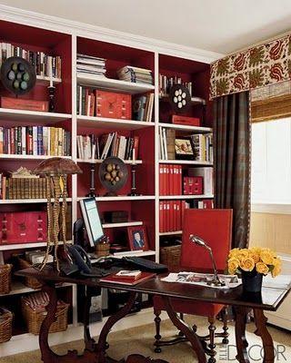 A Dallas Decorum library with deep red bookcases and white edging - einrichtungsdeen fur hausbibliothek bucherwand