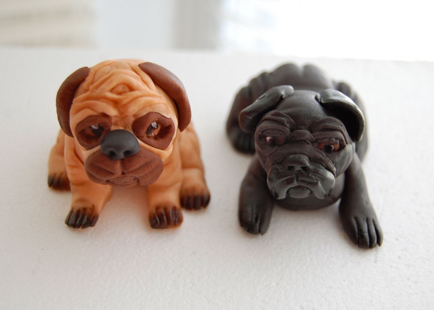 http://www.etsy.com/listing/124708409/fondant-pugs-cake-topper?ref=shop_home_active