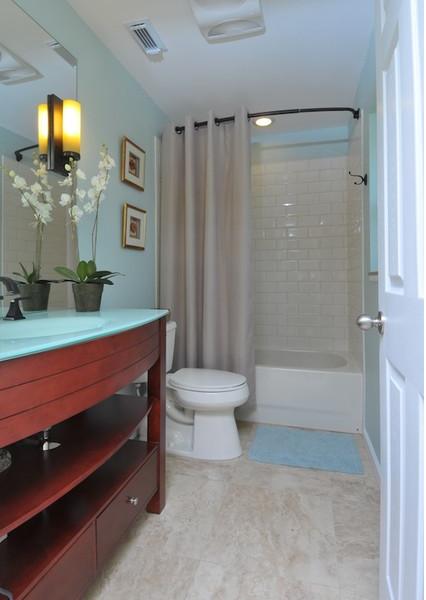 Beautiful light blue bathroom with cherry wood cabinets - Light blue bathroom ideas ...