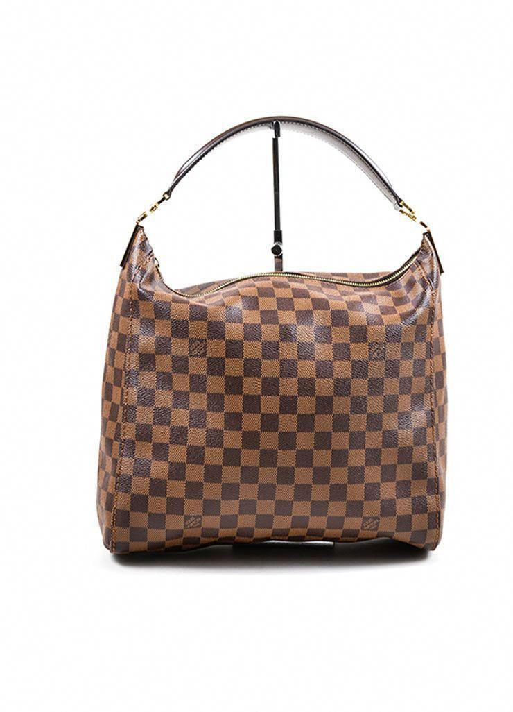 9633fecf6aa7 This Louis Vuitton tote bag is a must-have for everyday use. Constructed of  iconic Damier Ebene canvas. A gold toned top zipper closure keeps your ...
