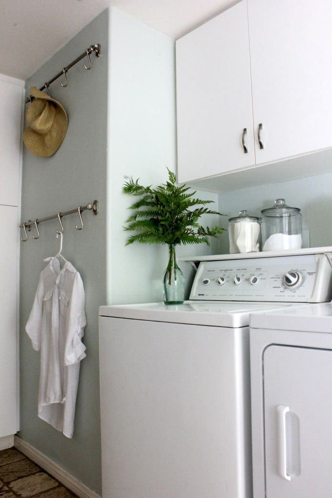 A Rod With Hooks In The Laundry Room For Hanging Clothes Straight