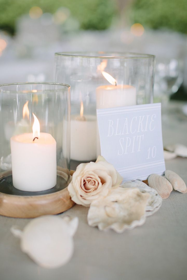 Candles + pebbles + flowers + shells Wedding Centerpiece | fabmood.com #beachwedding #weddingideas