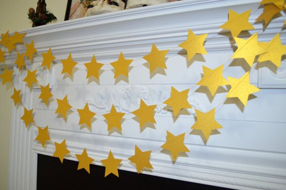 GOLD STAR GARLAND - This garland is made of metallic rich gold paper stars that is sewn together with sturdy gold thread. This would be so cute