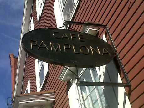 Café Pamplona, in Harvard Square (Cambridge, MA): This place might not look like much from the outside, but don't let that fool you. It's a got a special kind of charm all of its own. It's cozy and inviting on the inside, and they make a mean mocha. :) It's a favorite old haunt of mine. Many good memories were formed there.  (More info: http://en.wikipedia.org/wiki/Caf%C3%A9_Pamplona.)