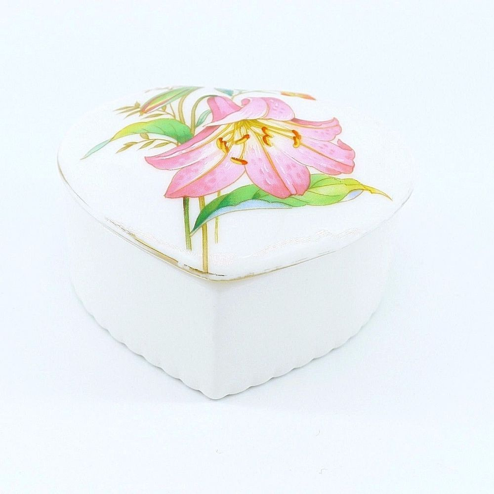 Vintage flambro spring fantasy lily heart shaped trinket box flower the lid of the box is decorated with a lily flower design the base is solid white use on your vanity or bathroom izmirmasajfo