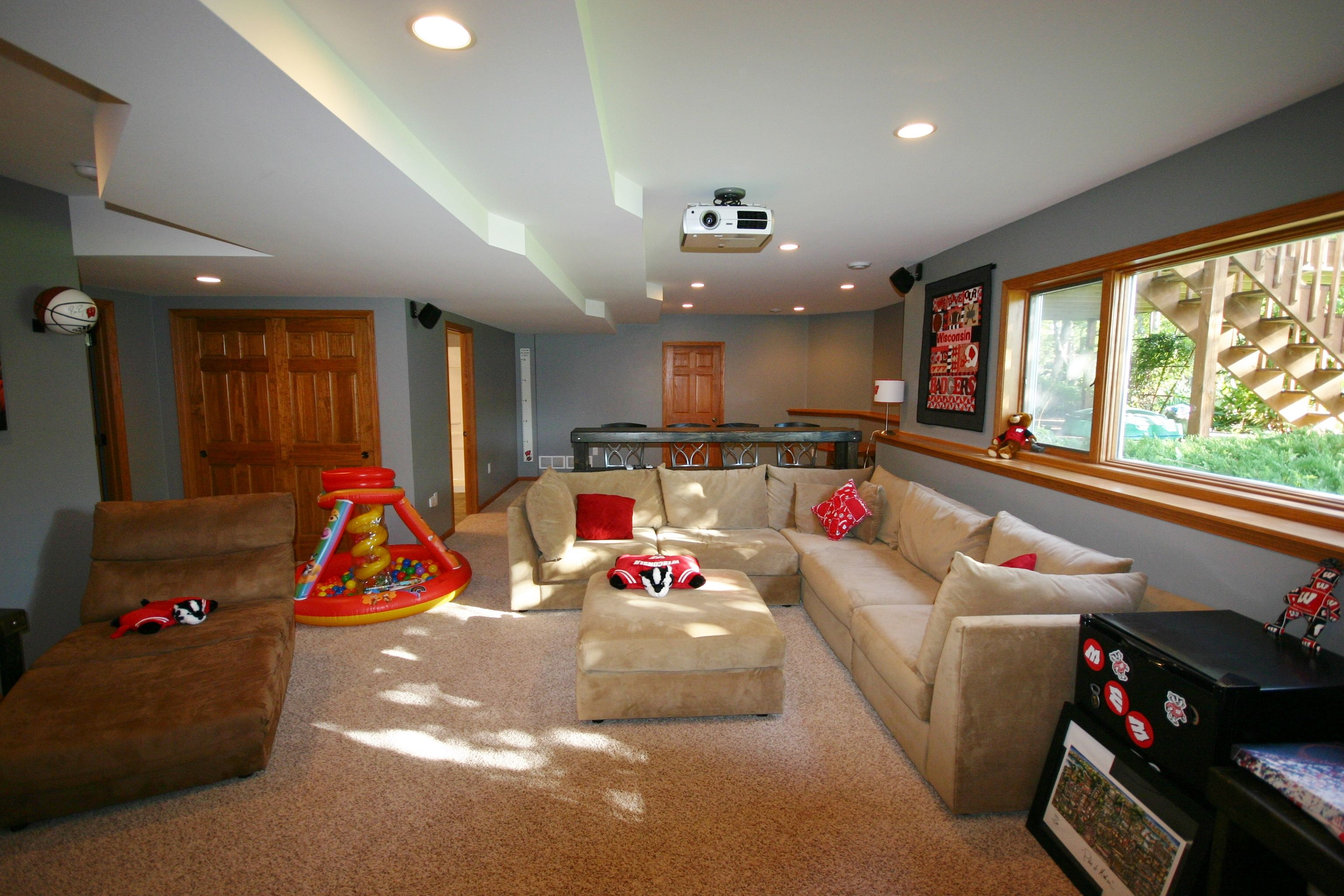 Basement Finish, With Carpeting, Oak Trimmed Ledge, Projector Screen, Man