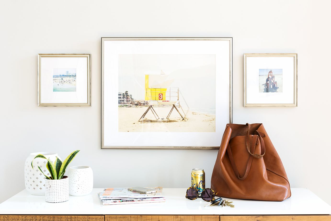 Art by @maddenphoto in our glossy pewter Ventura frame is balanced by two vacation Instagrams in our silver Newport frame