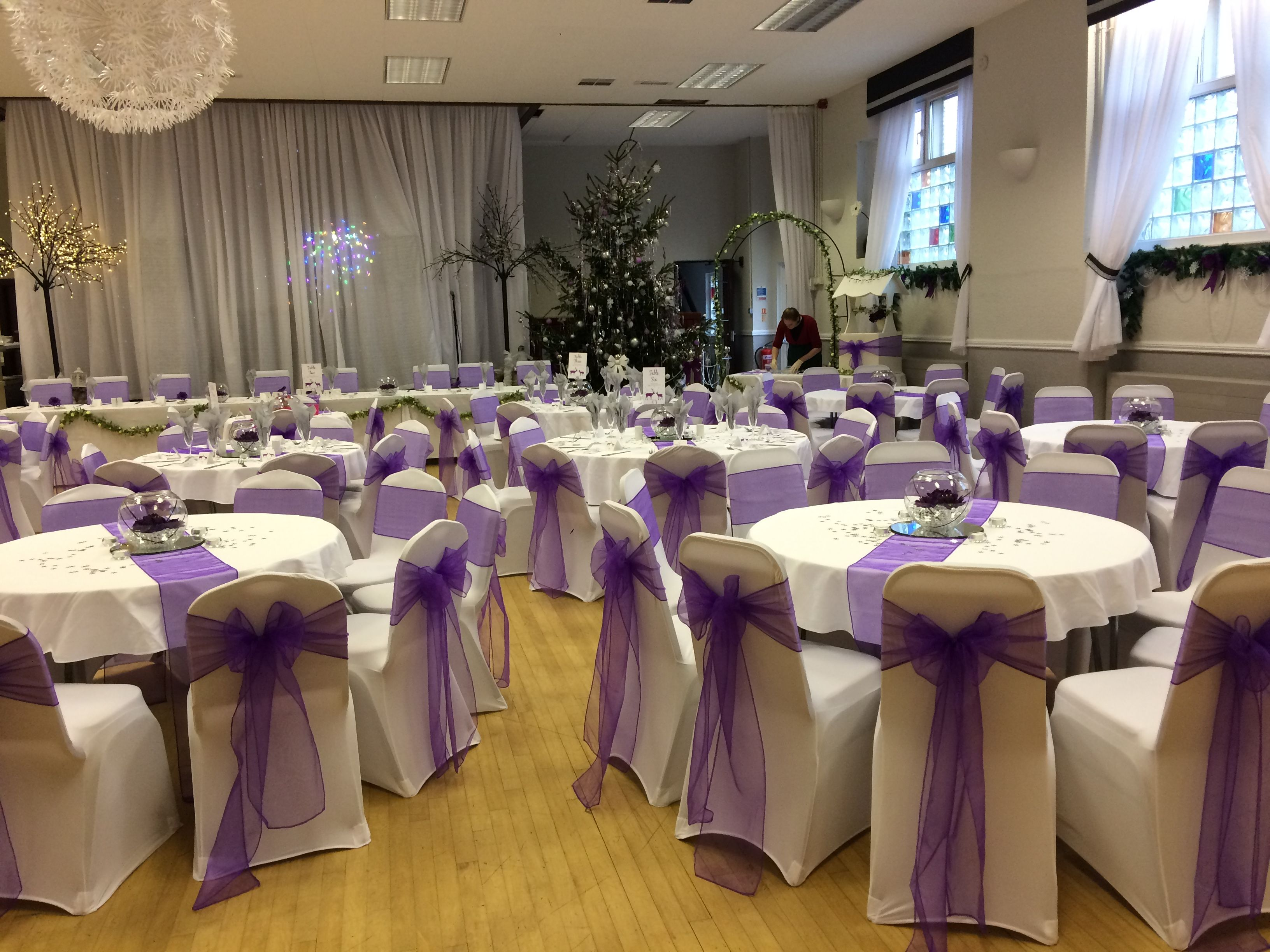White Chair Covers And Cadburys Purple Sashes At A Wedding In Ammanford South Wales Venue Dressed By Ww Purple Wedding Theme Wedding Hire Wedding Decorations