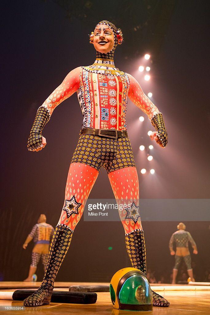 A cast member of Cirque Du Soleil TOTEM performs during