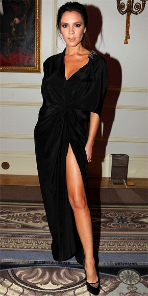 Beckham wore her own design featuring a high slit and crystal embellishment on the plunging neckline to the British Fashion Awards.