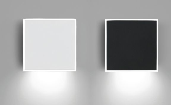 Square wall light designed by Ramos & Bassols. Available