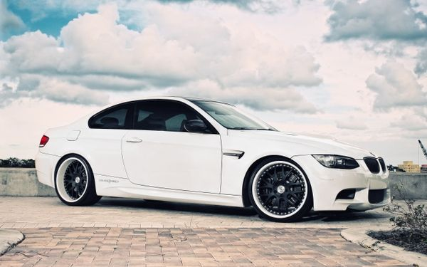 BMW With Some Kind Of White Wall Rims Or Tires.