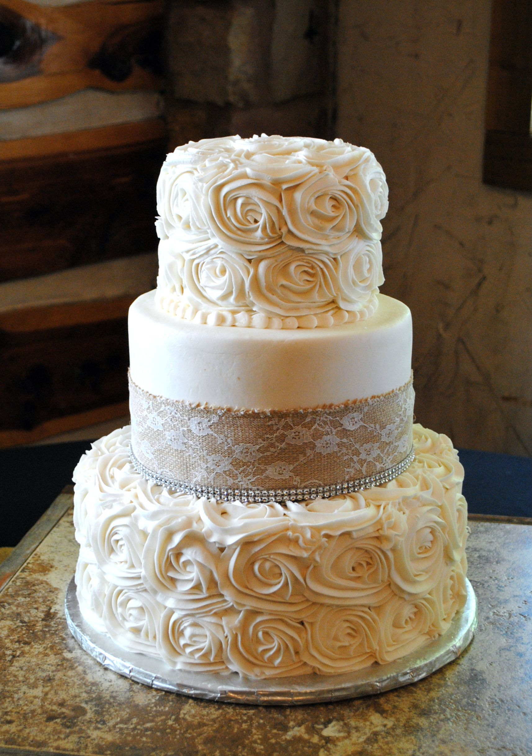 burlap and rosette wedding cake