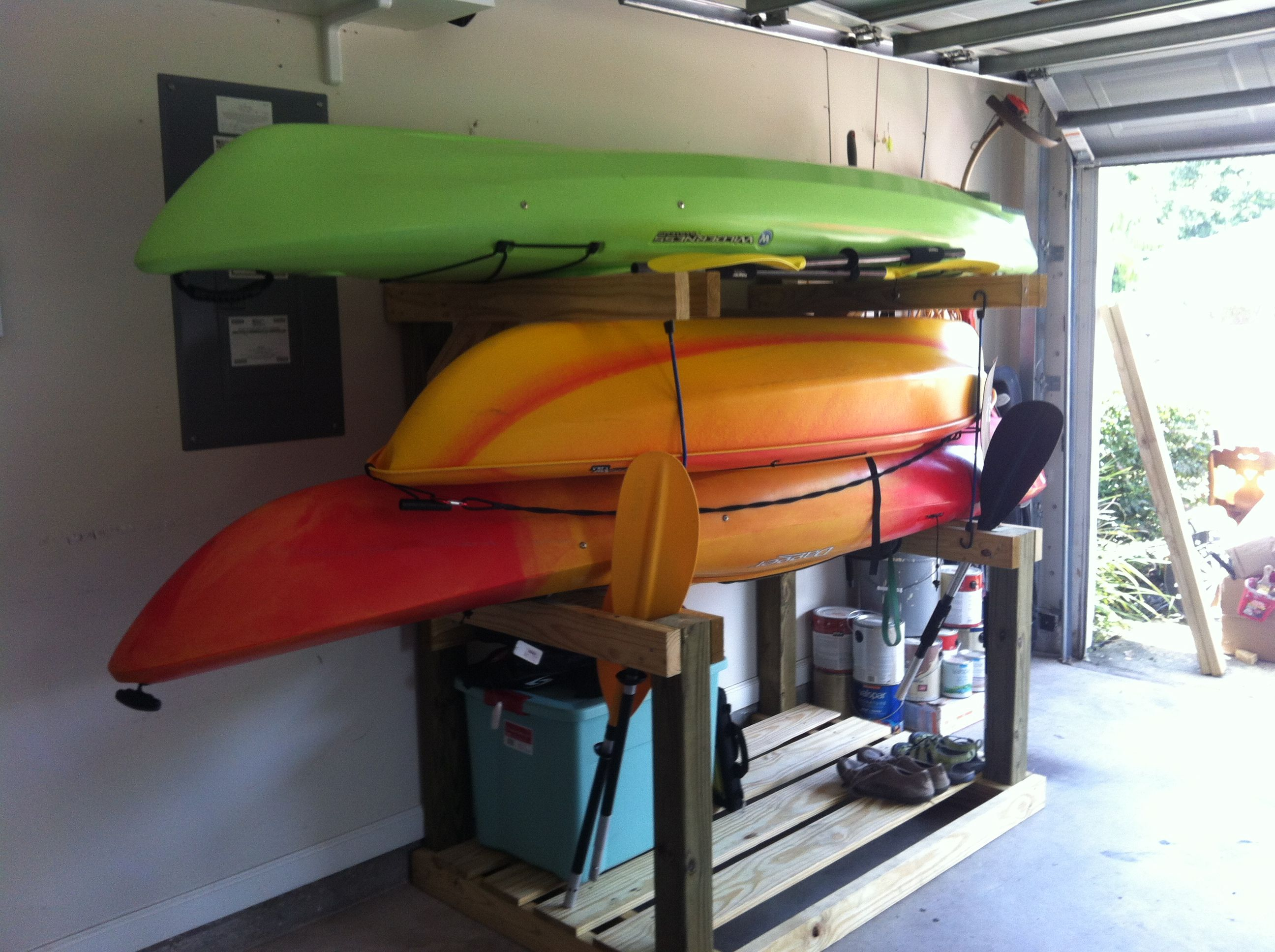 Chris made our kayaks a home now we have the garage back