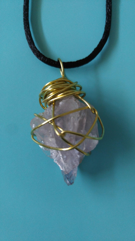 Amethyst pendant wrapped in brass